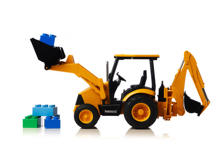backhoe tractor with brick toys, white background