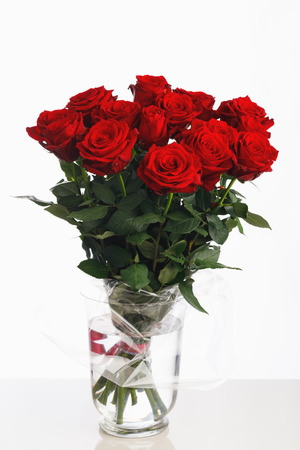 red roses bouquet on white background, fifteen flowers