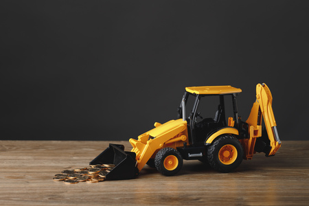 backhoe tractor rake up money coins