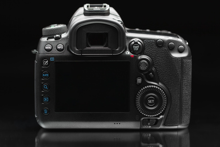 dslr photo camera body on black background