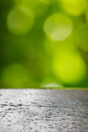 wooden basis and green nature bokeh background