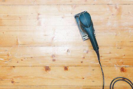 wooden floor sanding with flat sander tool