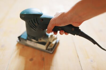 wooden floor sanding with flat sander tool