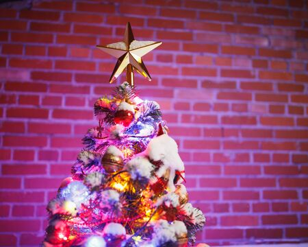 Christmas tree against brick wall background