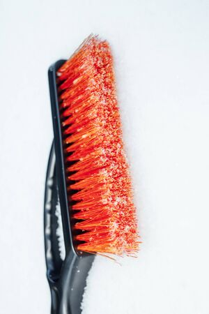 orange snow brush for car, snowflakes background Stok Fotoğraf