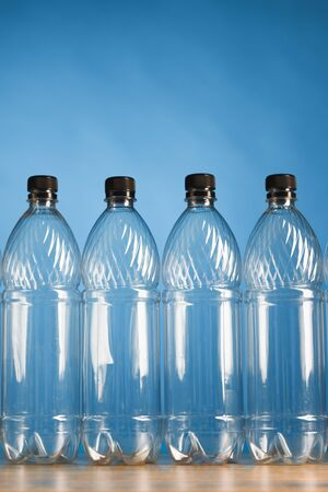empty plastic bottles on blue background