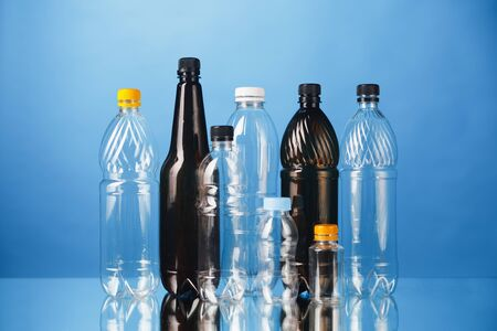 variety of plastic bottles on blue background Stockfoto