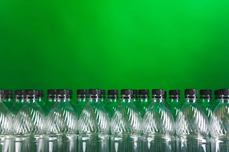 empty plastic bottles on green background