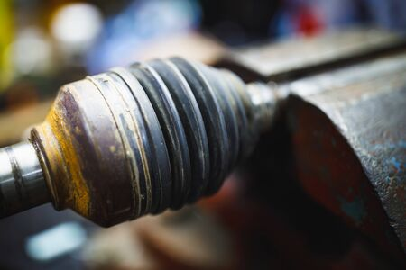 ATV constant-velocity CV joint repair in old garage