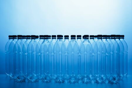 empty plastic bottle silhouettes on blue background Stockfoto
