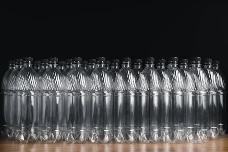 empty plastic bottles on black background Stockfoto