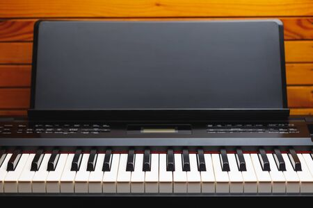 digital piano keys with music stand, copy-space background Stockfoto