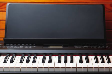 digital piano keys with music stand, copy-space background Stock Photo