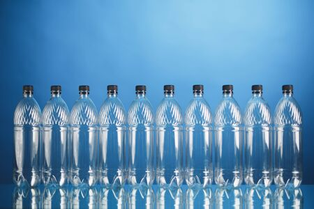 empty plastic bottles on blue background Stockfoto