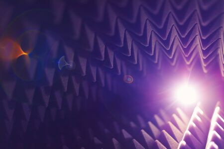 acoustic foam pyramid abstract background with glow light Stock Photo