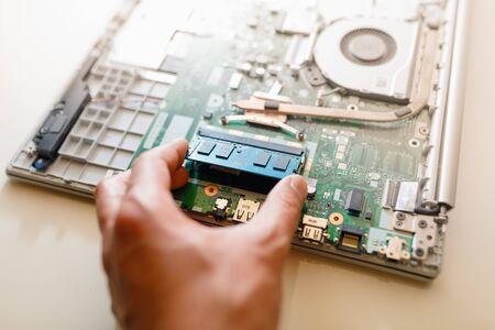 memory module ddr4 ram installation in laptop by hand