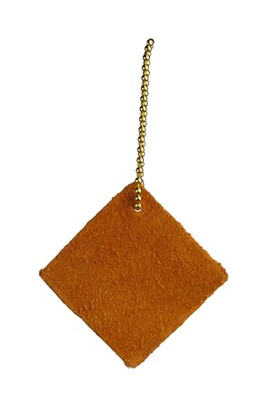 leather shape sample tag on small chain, isolated on white Foto de archivo