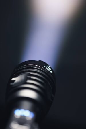 ray of pocket flashlight in smoke, copy-space background
