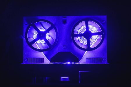 reel to reel audio tape recorder with violet led light strip