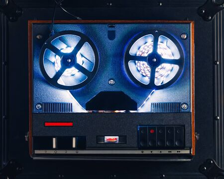 reel to reel audio tape recorder with blue led light strip