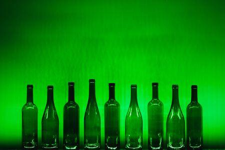 abstract empty wine bottles with green illumination