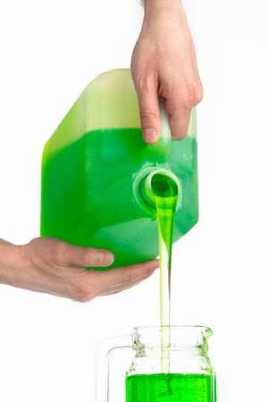 liquid soap in plastic bottle, pouring by hands