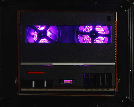 reel to reel audio tape recorder with purple led light strip. VU meter with