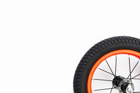 part of kids bicycle wheel with spokes, white background Imagens
