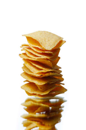 mexican nachos tortilla chips stack, isolated on white