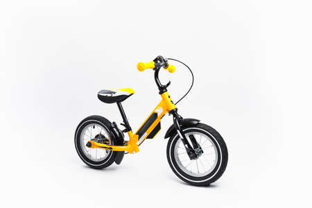yellow balance bike on white background Banque d'images - 157942206