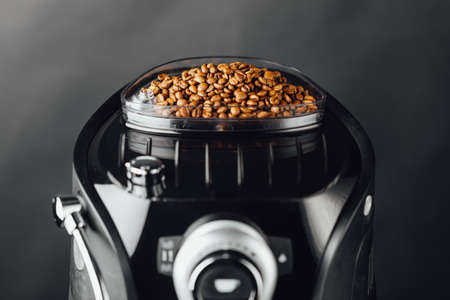 coffee beans in coffeemaker bean container, close-up view