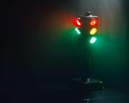 traffic lights at night in dense fog