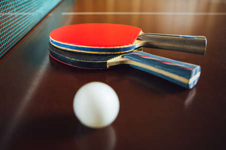 table tennis rackets and ball, close-up view