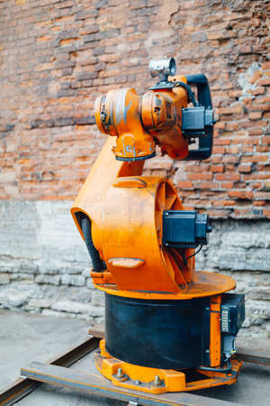 robotic arm against brick wall background