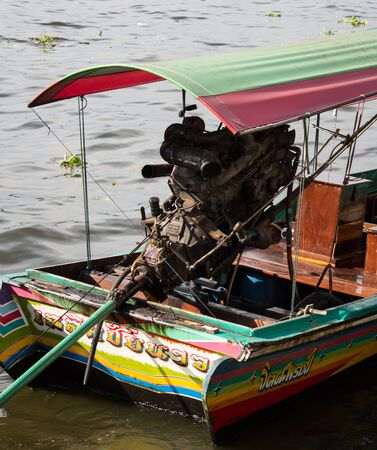 outboard: Big outboard diesel engine on a small tourist transportation boat in Bangkok, Thailand, Asia.