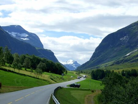 Road 63 in Norway. Mountain with snow top can be seen on horizon. Stock Photo