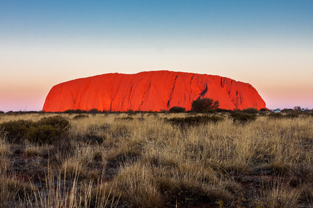 travel features: Mount Uluru on a background of clear sky at sunset. Australia