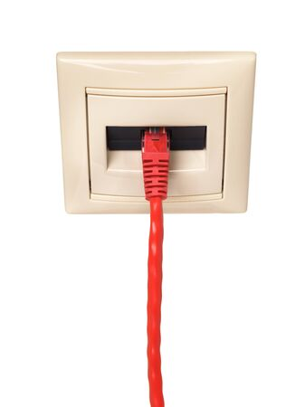 rj 45: Red cable with RJ-45 connector is connected to a wall outlet. Close-up. Isolated on white background. The cable is red color and the socket is light cream color.