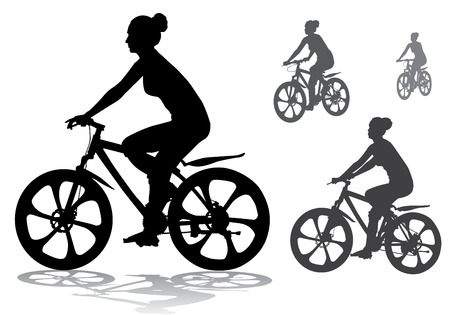 cycling silhouette: girl rides a bicycle on a walk