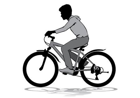 Ein Junge, der fährt mit dem Fahrrad auf einem Spaziergang.