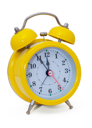 background box: Clock. Alarm clock, in a yellow box, on a white background. Isolated