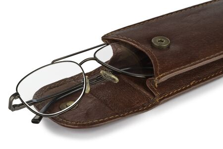 Glasses for myopia in a leather case on a white background