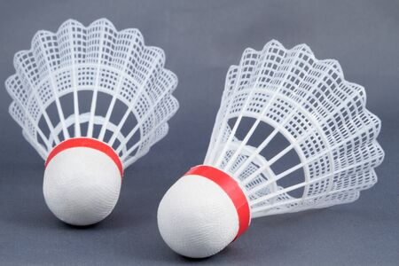 fast plastic shuttlecocks for badminton with a red stripe Stock Photo