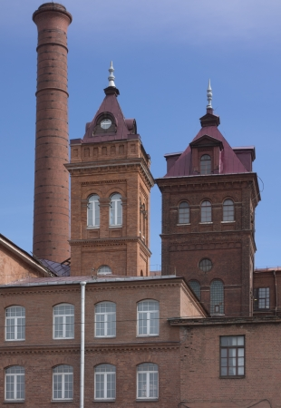 Chimney and the two towers of the old red-brick factory