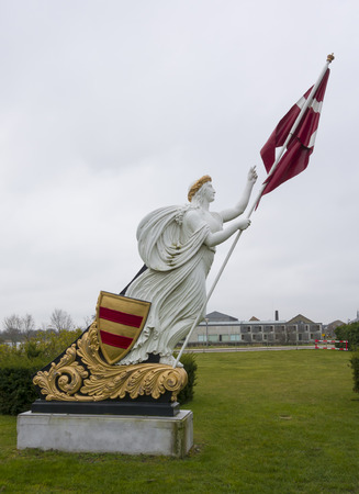 figurehead of a sailing ship in the form of the goddess with the flag of Denmark
