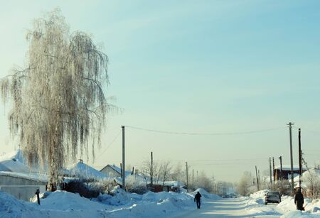 Snowy winter has come to the village street photo