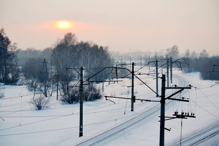 cross ties: The railroad passes through the winter forest-steppe of Altai