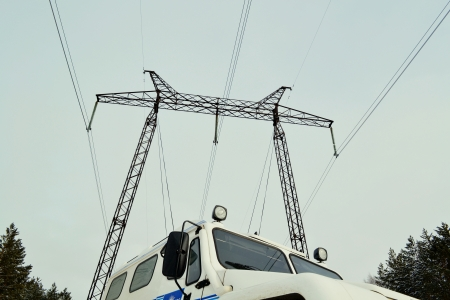 The high-voltage line passes through the winter forest-steppe of Altai