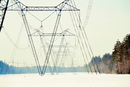 kw: The high-voltage line passes through the winter forest-steppe of Altai