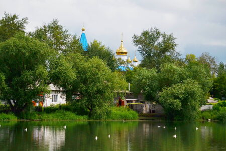 gold en: Around the world wooden and brick temples cost stand  in steepe region Altaya Stock Photo